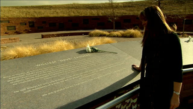 student day of mourning / call for change in gun laws colorado columbine memorial coni sanders looking at memorial to her teacher father at columbine... - memorial stock videos and b-roll footage