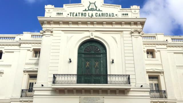 santa clara, cuba: charity theatre facade (spanish: teatro la caridad) - landmark theatres stock videos & royalty-free footage
