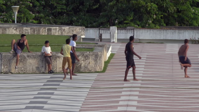 Santa Clara, Cuba: Che Guevara Memorial or plaza. Cuban youth playing soccer.  Point of view from the statue base to the esplanade