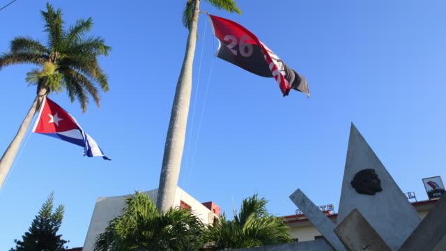 santa clara, cuba, cuban flags in the pcc headquarters - communist flag stock videos & royalty-free footage