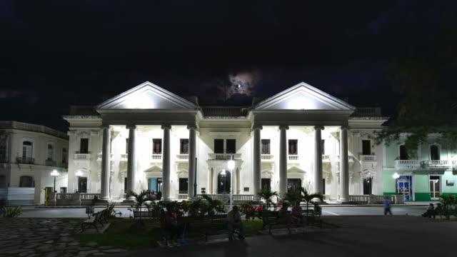 santa clara, cuba: jose marti public library facade at night, time lapse - column stock videos & royalty-free footage