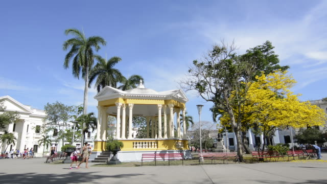 santa clara cuba main square with locals and colorful trees and gazebo in central downtown - gazebo stock videos and b-roll footage