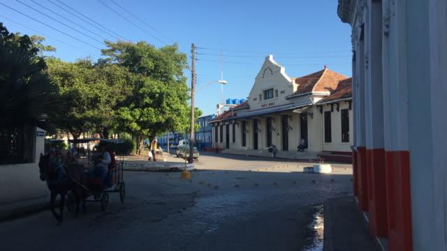 santa clara, cuba: marta abreu train station, everyday lifestyle around the colonial architecture building - horsedrawn stock videos & royalty-free footage
