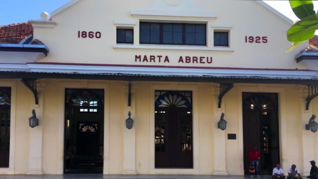 santa clara, cuba: marta abreu train station, everyday lifestyle around the colonial architecture building - western script stock videos & royalty-free footage