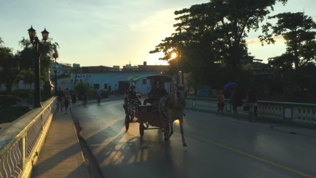 santa clara, cuba: the cross bridge (puente de la cruz) - horsedrawn stock videos & royalty-free footage