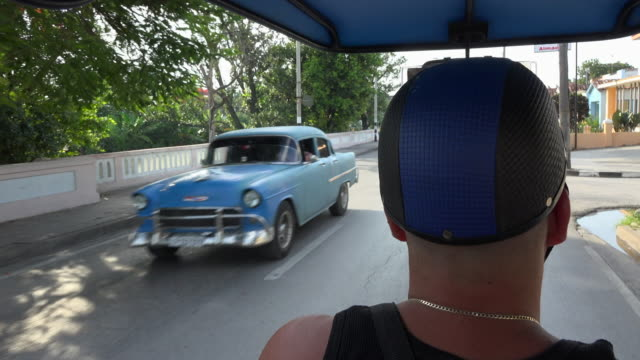 santa clara, cuba transportation: 'motoneta' passenger point of view while driving in the central road. - passenger point of view stock videos & royalty-free footage