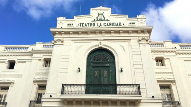 santa clara, cuba:tilt down of the charity theatre facade (spanish: teatro la caridad) - landmark theatres stock videos & royalty-free footage