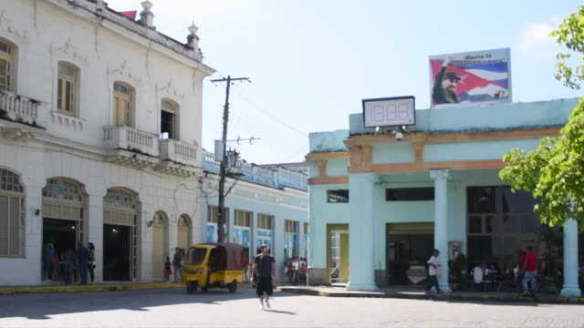 santa clara, villa clara, cuba-july 5, 2018: the bookstore is the cream-colored building. there is an image of fidel castro to the right. this area... - cream coloured stock videos & royalty-free footage