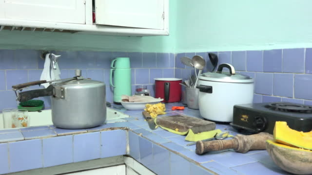 vídeos de stock e filmes b-roll de santa clara, villa clara, cuba-june 27, 2020: a view of a real-life kitchen inside of a middle-income household. lifestyles of real cuban people. the... - crucifers