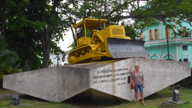 santa clara, villa clara, cuba-october 10, 2019: a female tourist have her photo taken by the armoured train derailment monument which is a national... - artistic product stock videos & royalty-free footage