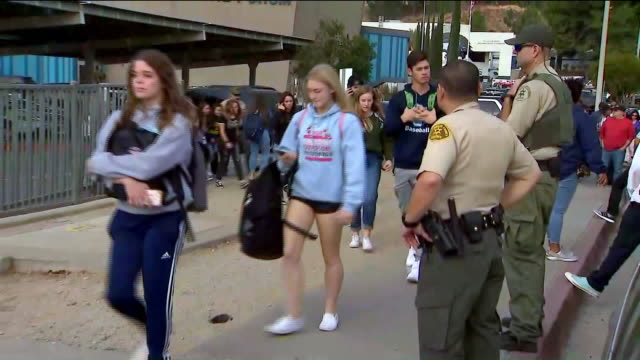 santa clarita, ca, u.s. - students walking out of saugus high school after shooting in santa clarita on thursday, november 14, 2019. - santa clarita stock videos & royalty-free footage