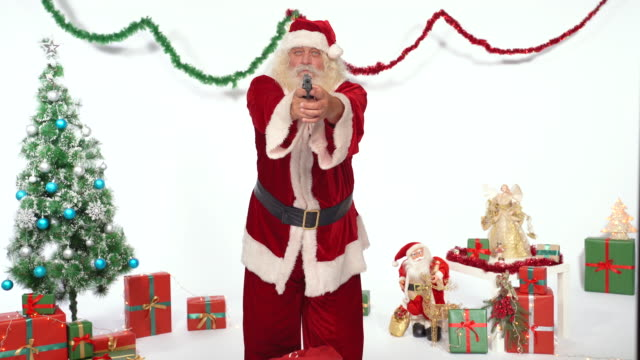 santa claus aiming at camera with a gun - furious stock videos & royalty-free footage