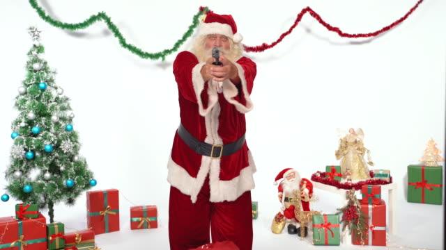 santa claus aiming at camera with a handgun - pointing stock videos & royalty-free footage
