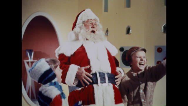 vídeos de stock e filmes b-roll de 1964 santa claus and two children announce their departure back to earth - pai natal