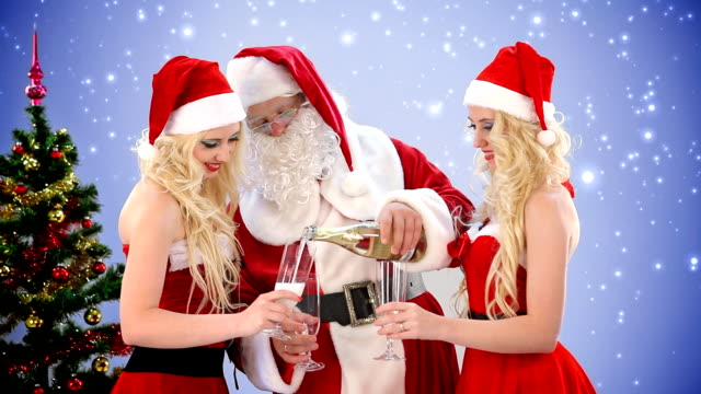 santa claus and two women drink champagne - sensuality stock videos & royalty-free footage