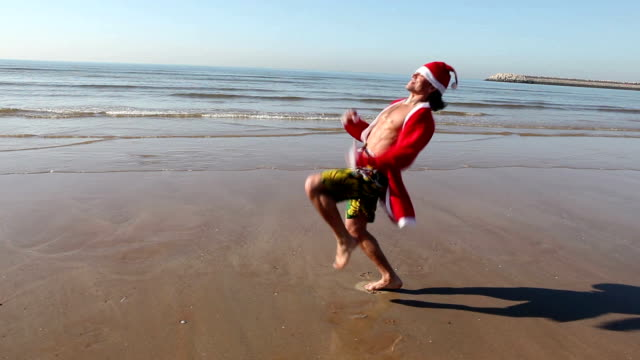 santa claus at the beach - father christmas stock videos and b-roll footage