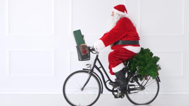 santa claus biking/ debica/ poland - christmas present stock videos and b-roll footage
