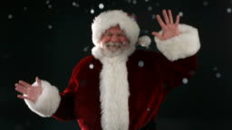 Santa Claus dancing in the falling snow, slow motion