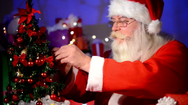 santa claus  decorating christmas tree - christmas stocking stock videos and b-roll footage