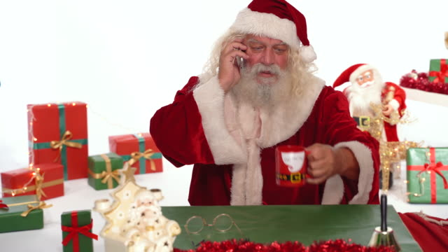 santa claus drink milk,coffee, tea and talking on the phone - mug stock videos & royalty-free footage