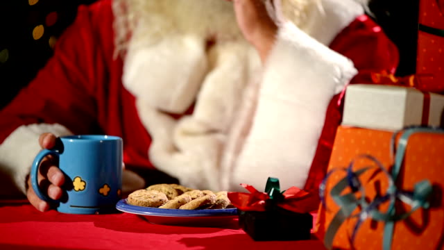 santa claus eat cookies - father christmas stock videos & royalty-free footage