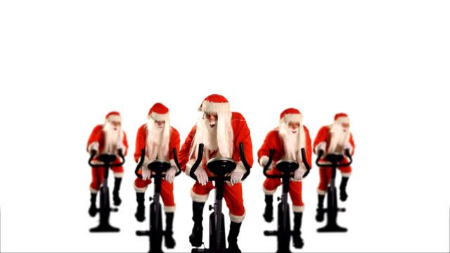 stockvideo's en b-roll-footage met santa claus exercising and training - kerstman