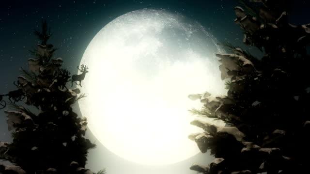 vídeos de stock, filmes e b-roll de papai noel voando na frente da lua - snow cornice
