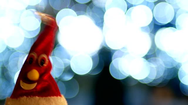 santa claus' hat, christmas tree, night, christmas lights - santa hat stock videos & royalty-free footage