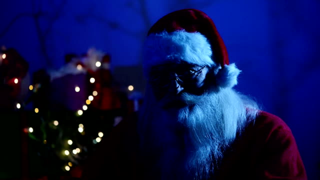santa claus  holding a gun - negative emotion stock videos & royalty-free footage