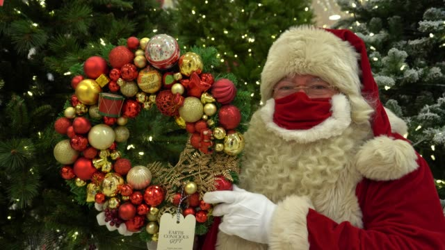 santa claus holds a christmas wreath made from recycled materials part of selfridges project earth range during the launch of the selfridges... - wreath stock videos & royalty-free footage