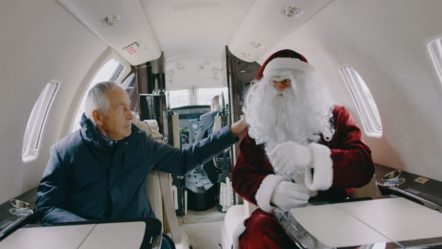 santa claus in private jet airplane - next to stock videos and b-roll footage