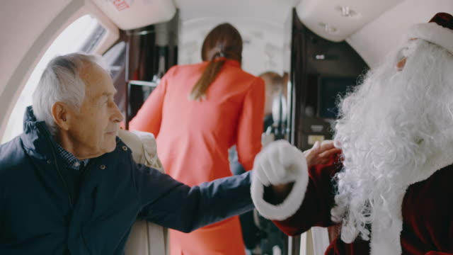 santa claus in private jet airplane - captain scarlet stock videos and b-roll footage