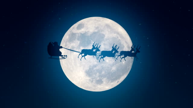 vídeos de stock e filmes b-roll de santa claus is flying in his sleigh over a full moon - pai natal