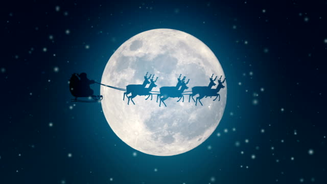 santa claus is flying in his sleigh over a full moon - sledge stock videos & royalty-free footage