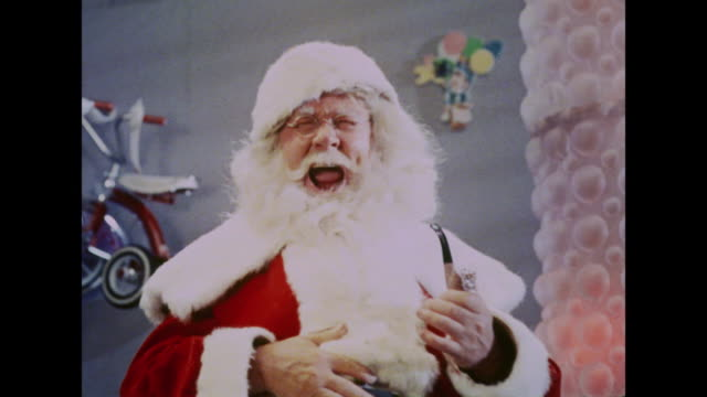 vídeos de stock e filmes b-roll de 1964 santa claus laughing heartily - pai natal