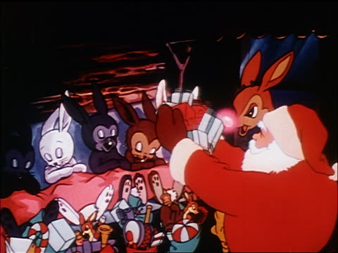 animated santa claus leaving gifts for sleeping bunny rabbits as rudolph watches / sound - weihnachtsgeschenk stock-videos und b-roll-filmmaterial