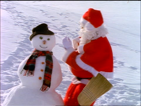 santa claus making snowman - 1997 stock videos & royalty-free footage
