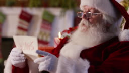 Santa Claus reading letter from child, closeup
