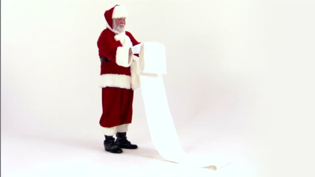 Santa Claus reading list of naughty and nice