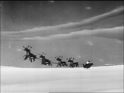 vídeos de stock e filmes b-roll de b/w animated santa claus + reindeer taking off into air in sleigh / sound - papai noel