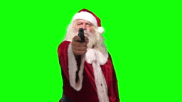 Santa Claus robber with a gun threating camera in front of chroma key green screen background