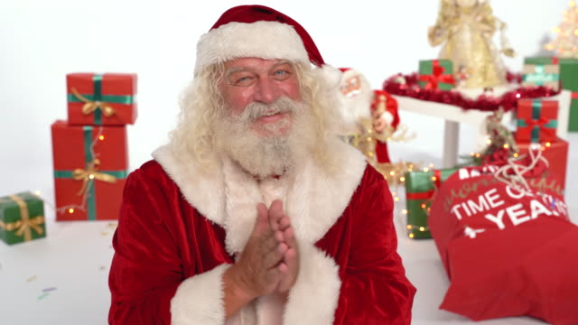 santa claus rubbing hands together and smiles at you - rubbing hands together stock videos and b-roll footage