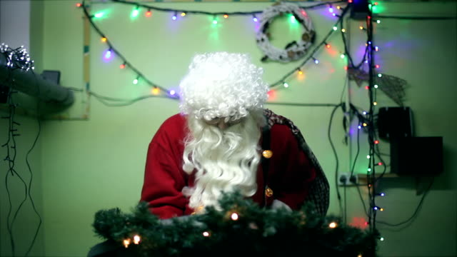 santa claus running on treadmill has accident, crash, funny, joke, humor, christmas decoration - health club stock videos & royalty-free footage