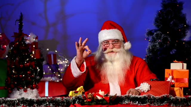 Santa Claus showing thumbs up and ok sign