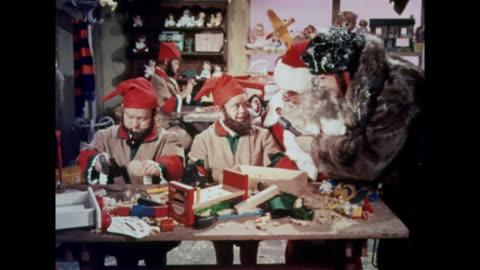 1964 santa claus shows a news reporter a newly built space ship and martian toys - nordpolen bildbanksvideor och videomaterial från bakom kulisserna