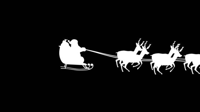 stockvideo's en b-roll-footage met santa claus silhouet - kerstman
