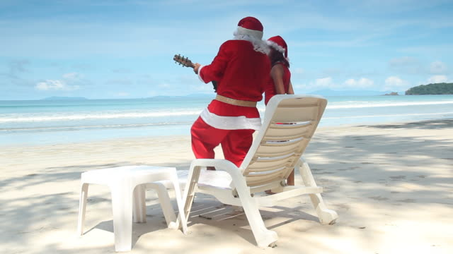 santa claus sing and dance on the beach - sensuality stock videos & royalty-free footage