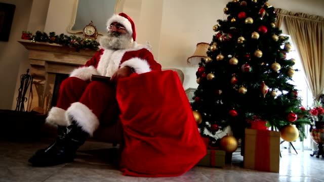 Santa Claus sitting at home