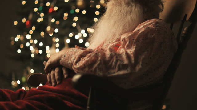 santa claus sitting in a rocking chair asleep - rocking chair stock videos & royalty-free footage