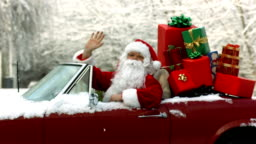 Santa Claus sitting in convertible piled with Christmas gifts